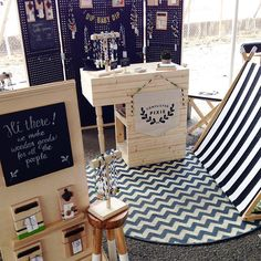 Love the use of black, white and natural wood to pull the space together. Love the rug too. Cute chalkboard signage and cash desk.