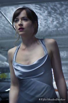 Ana's satin silver dress. | Fifty Shades Darker Movie | In theaters Valentine's Day