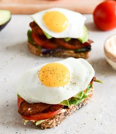 ingredients: 6 slices thick-cut bacon, fried 4 slices whole grain bread, toasted 1/4 cup mayonnaise 1/2 teaspoon sriracha (or your favorite hot sauce) 2 bunches of baby romaine lettuce 1 tomato, sliced + seasoned with salt and pepper 1/2 avocado, sliced + seasoned with salt and pepper 2 eggs, cooked as desired