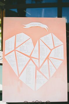 cutout seating chart, photo by Onelove Photography http://ruffledblog.com/romantic-wedding-handcrafted-by-the-groom #seatingchart #weddingideas