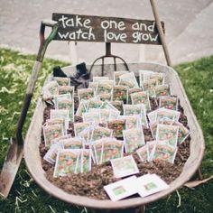 Plant your own wedding favors, frön i organzapåsarna med en sån skylt och i en skottkärra