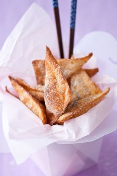 Chocolate won tons  Makes 12  1 egg  1 tablespoon water  12 wonton wrappers  12 pieces of chocolates (I used about 4 chocolate chips per wonton)  high heat oil for frying (I used canola)  Powdered sugar for dusting