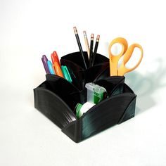 Way cooler than a bowl! It's a desk organizer made of recycled records.