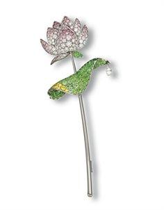 A DELICATE COLOURED DIAMOND, DIAMOND AND DEMANTOID GARNET 'LOTUS' BROOCH, BY GIMEL
