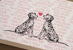 """Who doesn't love dogs especially when they are in love! This card features two black and white dalmatian dogs with a pink """"love notes"""" pattern behind the dogs. This is a perfect card for Valentine's d"""