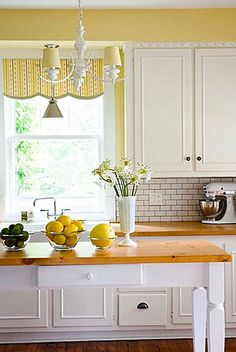 love yellow and white kitchens