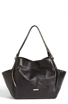 $995, Black Leather Tote Bag: Burberry Canterbury Leather Over Shoulder Tote Medium Black. Sold by Nordstrom. Click for more info: https://lookastic.com/women/shop_items/138269/redirect