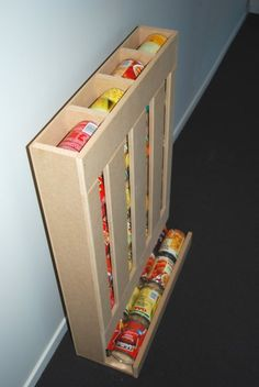 DIY RV Food Storage Can Dispenser: Keep the RV Pantry Organized I love this idea for storing canned food! Very efficient, keeps food rotated and takes up much less space than most storage shelving! I bet this could be made using old pallet boards too!