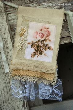 Ye Shabby Roses HANDMADE Shabby Chic Fabric Collage Festoon. $24.95, via Etsy.