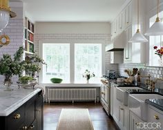 Black, white, marble, brass, subway tile kitchen.  Yum.