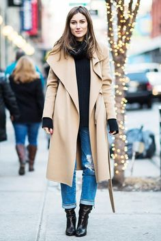 Giorgia Tordini in one of the season's best coats // camel coat, black turtleneck, ripped boyfriend jeans & boots #style #fashion #fall #winter #streetstyle