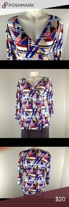 Dana Buckman wrap shirt three-quarter sleeves XL Dana Buckman wrap shirt size extra-large  measurements  Bust 42 inches Waist 34 inches note material very stretchy Length from collar to hem 24 inches Recorder sleeves  95% rayon 5% spandex Dana Buchman Tops Blouses