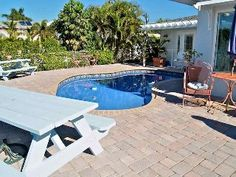 Paradise Home - Spacious Waterfront Home cheesey bed spreads but good reviews, private pool and it has good location