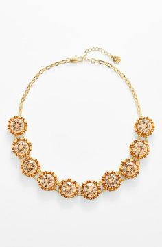 This Tory Burch necklace sparkles like the sun.