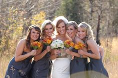 bridesmaids in grey with orange bouquets - good colors!