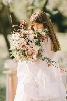 Asymmetric bridal bouquet following this year's maximalist trend. Created in a sauvage style, with a mix of flowers and scents. Floral Wreath, Coral, Bloom, Wreaths, Bridal Bouquets, Wedding Dresses, Spring, Fairytale, Flowers