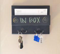 Mail organizer blackboard mini one pocket wall mounted with key hooks. $40.00, via Etsy.