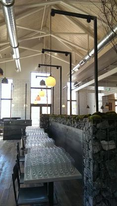 Light fixtures, steel wall work, gabion build, tables and chairs by in Nashville, TN East Lansing, Back Bar, Bbq Ideas, Beer Taps, Steel Wall, Nashville, Light Fixtures, Tables, Chairs