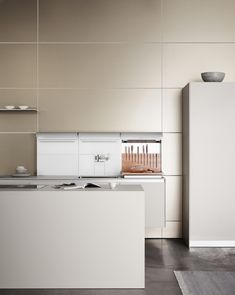 In a bulthaup b3,  the walls can be used to create more storage space. You decide how to put this additional storage space to use. Options include elements such as the knife block and chopping board.