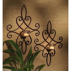 Listed here are the beautiful wrought iron wall decor and items for wrought iron wall art. Bring home the life with wrought iron wall decoration like scones, wrought iron candle stand, wall art, metal wall shelf and many more. Wrought Iron Candle Holders, Wall Candle Holders, Candle Wall Sconces, Wrought Iron Wall Decor, Metal Wall Decor, Chandelier Bougie, Iron Furniture, Pot Racks, Wine Racks