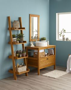 Luminous blue bathroom with its furniture under washbasin Surabaya wooden. furniture Source by fourniercarolin