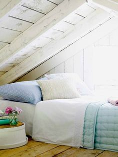 I never would have thought that an attic loft bedroom could look so cozy... that's the power of light colors... and it also helps to have the box spring and mattress on the ground without a bed frame so that there's extra space between your head and the ceiling.