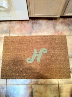 Stenciled rug using Cricut machine and paint. How cool to spell whole last name.