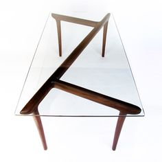 Ko Table by Element Design was created in the image of a Canadian forest. It feels as if you are sitting in a forest looking at branches in a lake. Because each piece of furniture is carefully carved by hand, none of them are exactly the same. The table is made from rich Walnut and supports a 12mm tempered glass top. It is finished with a delicate organic oil.