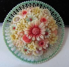 Celluloid brooch. Yummy colors. This would be so pretty on a crisp white blouse.