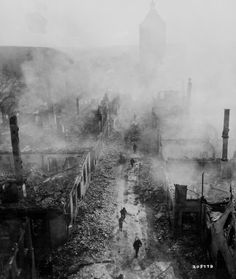 """. """"Infantrymen of the 255th Infantry Regiment move down a street in Waldenburg to hunt out the Hun after a recent raid by 63rd Division."""" 2d Lt. Jacob Harris, April 16, 1945."""
