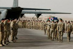 The casket of Corporal Cameron Baird who was killed in action on June 22 is escorted to the Royal Australian Air Force C-130 Hercules by his mates from the Special Operations Task Group.