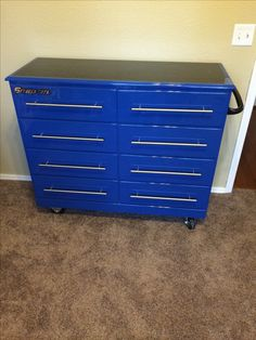 Restored wooden dresser to a SnapOn toolbox dresser for our son. My husband did all the work on my childhood dresser