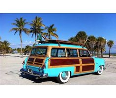 Instead of a limo, I want to drive away in a vintage Woody (in blue, of course).