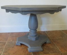 she painted the table gray, then glazed it with black and then glazed with white.  Great tutorial!