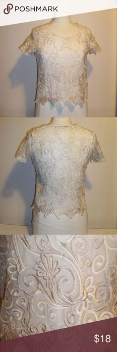 Gold Lace Crop Top I couldn't believe this was from Charlotte Russe!  This is a beautiful ivory and gold lace with a dagged bottom hem.  Would be beautiful as a cover up for an open formal gown, or dress it down with a bandeau top and jeans. Charlotte Russe Tops Crop Tops