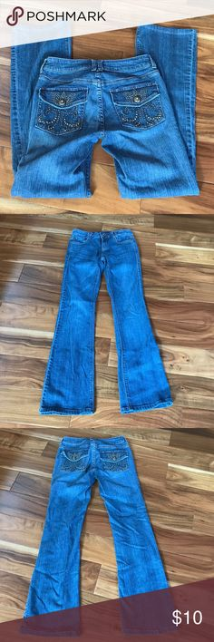 Cache bling pocket boot cut jeans Size photo posted.  Machine wash cold.  Photos 1-3 or taken in the sun color appears lighter. Close up of button photo 7. Slight/minor  wear on leg bottoms. Photos posted.  Flat waist  14 inches. Front rise 7 1/2 inches.  Inseam 30 inches.  Good condition no rips no stains. Cache Jeans Boot Cut
