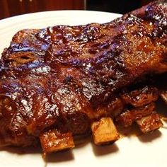 Easy BBQ Pork Ribs Recipe - A recipe for yummy slow Smoked BBQ pork ribs with an easy homemade barbecue sauce. Pork ribs smoked low and slow will change the way you look at cooking and eating eternally. Pork Spare Ribs, Bbq Pork Ribs, Bbq Beef, Pork Chop, Pork Roast, Barbecue Recipes, Pork Recipes, Cooking Recipes, Barbecue Sauce