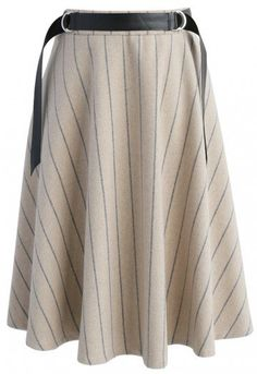 It's serious business, babes! With a practical design made of a wool-blend and simplistic pinstripes—this skirt serves up elegance and is also easy to style.  - Stripe pattern - Waist belt accompany - Concealed back zip closure - Lined - 35% Wool, 65% Viscose - Hand wash  Size (cm) Length  Waist   XS              63      68 S                63       72 M               64       76 Size (inch) Length  Waist   XS             24.5      26.5 S               24.5        28 M                25    …