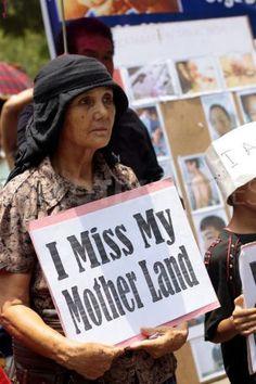 Burmese refugee woman  By: http://www.demotix.com/news/731365/burmese-refugees-and-activists-rally-world-refugee-day-new-delhi