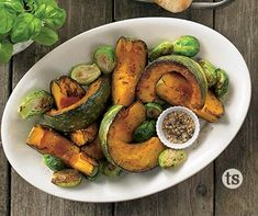 Smoked Maple Squash & Brussels Sprouts Recipe │Brussel sprouts, fresh acorn or kabocha squash baked with a smoky maple seasoning. A perfect fall side dish.