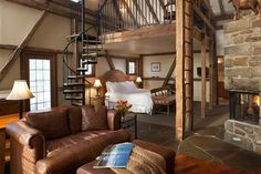 Spend your stay in one of the spellbinding stable suites, which boasts a spiral staircase, a king bed, a soaking tub, and a private patio. Weekend Cottages, Luxury Inn, Affordable Honeymoon, Romantic Weekend Getaways, Getaway Cabins, Farm Stay, Cabin Plans, Rustic Design, Dream Bedroom