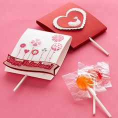 Lollipop Valentines - fold a piece of cardstock in half, insert lollipop inside, and embellish with store-bought scrapbooking stickers and messages. It makes a perfect afternoon activity to share with the kids.