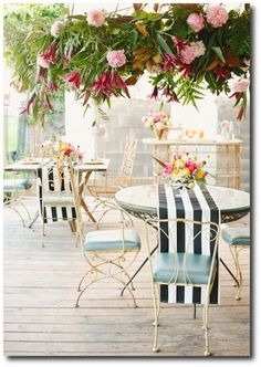 bistro seating and striped runners.