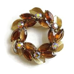 "This is a great Juliana Style Rhinestones Circle Brooch Leaf & Amber and Aurora Borealis Vintage!  This pin measures 2 1/8"" wide by 2 1/8"" high.  There are a very few barel... #vintage #jewelry #fashion #ecochic #vogueteam"