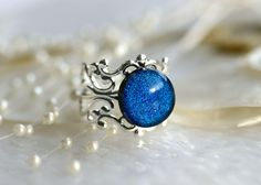 Hey, I found this really awesome Etsy listing at https://www.etsy.com/listing/116381585/filigree-ring-with-dichroic-fused-glass