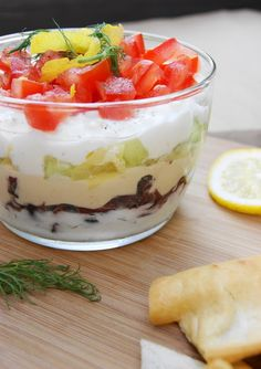 The Kitchen is My Playground: 7-Layer Greek Dip - With layers of hummus, creamy feta, tzatziki, kalamata olives, artichokes, cucumber, and tomatoes ... all laced with fresh dill and lemon
