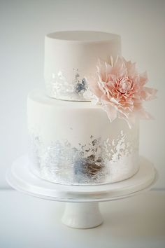 White wedding cake with distressed silver leaf ans sugar pink dahlia