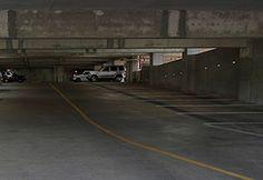 Parking garage after induction lighting retrofit.