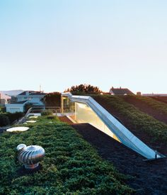 It Takes a Villa An angular hydroponic rooftop garden gently tops this suburban sustainable home in Liers, Spain. Photo by: Gunnar Knechtel