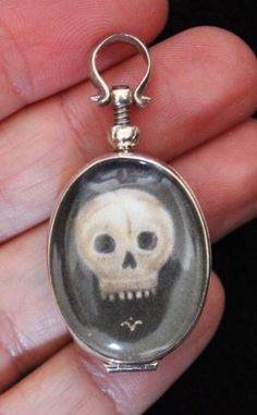 Victorian Momento Mori crystal skull charm necklace.